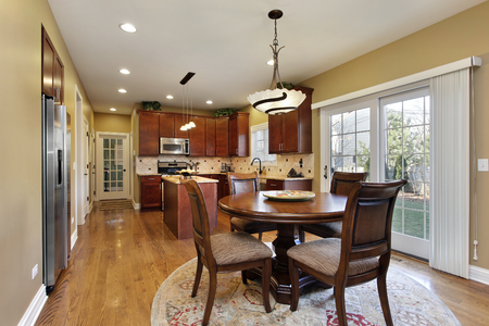 granite kitchen: Kitchen in suburban home with round table. Stock Photo