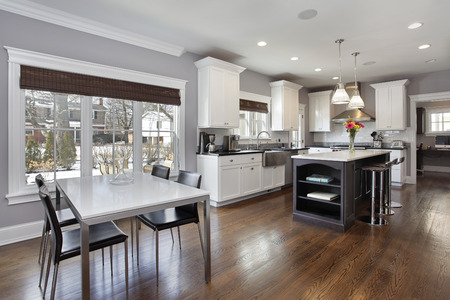 upscale: Large kitchen in upscale home with white cabinetry.