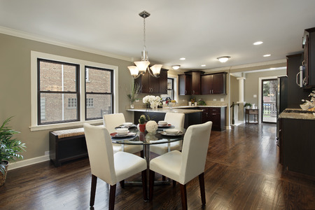 kitchen island: Kitchen in suburban home with large eating area.