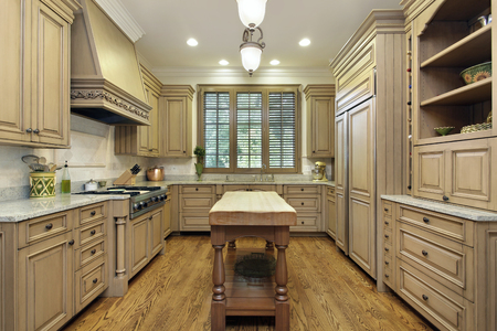 Kitchen in luxury home with butcher block island.