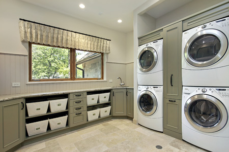 Laundry room in luxury home with dual washerdryer