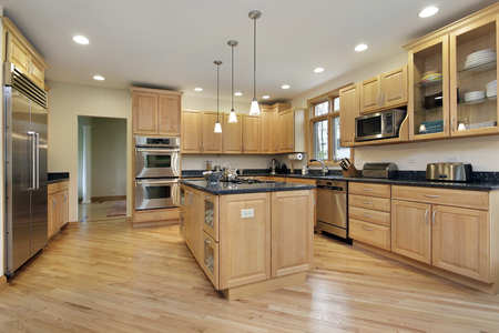 upscale: Large kitchen in upscale home with oak wood cabinetry. Stock Photo