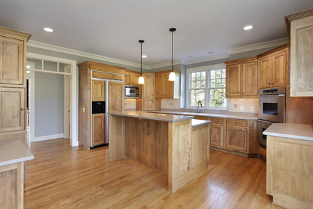 upscale: Kitchen in upscale home with double decker island.