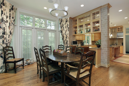 furnishings: Eating area in luxury home with kitchen view Stock Photo