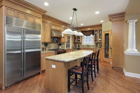 Kitchen in upscale home with large center island. Stock Photo