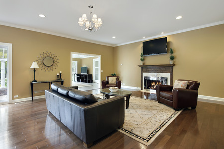 upscale: Family room in upscale home with fireplace. Stock Photo