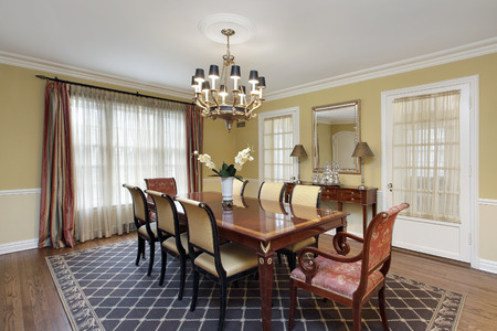 furnishings: Dining room in suburban home with gold walls.