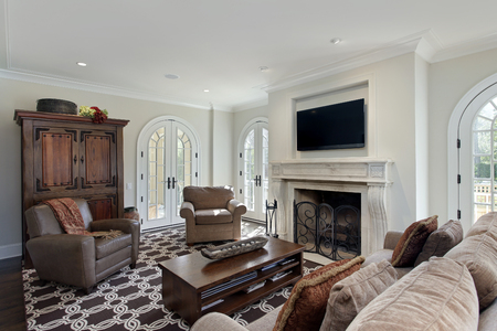 fireplace living room: Family room in luxury home with fireplace.