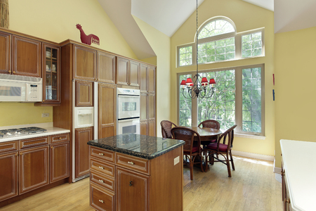 furnishings: Kitchen in suburban home with eating area. Stock Photo