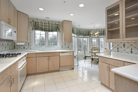 Kitchen in suburban home with eating area. Stock Photo