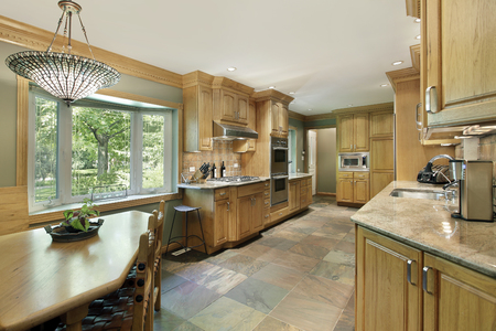 kitchen island: Kitchen in contemporary home with oak wood cabinetry. Stock Photo