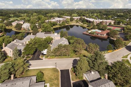 suburban neighborhood: Aerial view of community with pond Stock Photo
