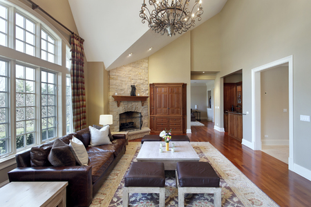fireplace living room: Living room in luxury home with stone fireplace.