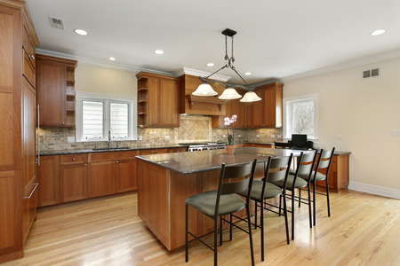 kitchen island: Kitchen with center island and oak wood cabinetry.