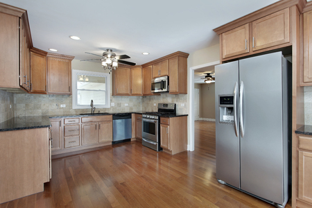 upscale: Kitchen in suburban home with cherry wood cabinetry. Stock Photo