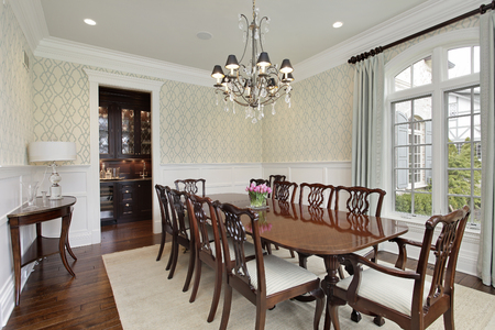 furnishings: Dining room in luxury home with adjacent bar.