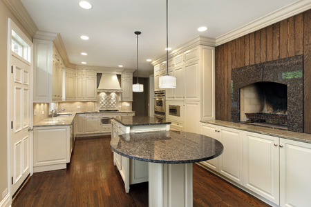 Kitchen in suburban home with fireplace.