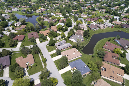 Aerial view of a neighborhood in suburban Chicago with two ponds. Reklamní fotografie