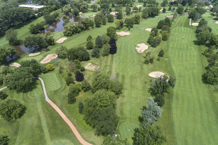 Aerial view of a suburban Chicago golf course with golfers, fairways and sand traps in Glencoe, IL. USA