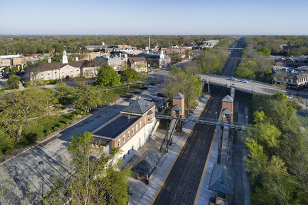 Aerial view of a business district with train station and taxi cabs waiting for commuters during an early spring morning in a suburban setting outside Chicago. Winnetka, IL. USA Reklamní fotografie