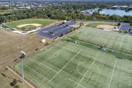Aerial view of a high school playfield with baseball diamonds and a football field in Glenview, IL. USA