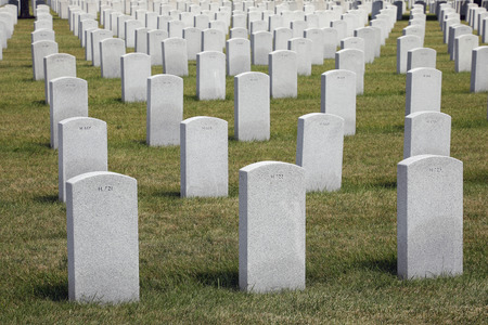 Southern Wisconsin Memorial Veterans Cemetery with small, numbered tombstones situated in rows. Union Grove, WI. USA
