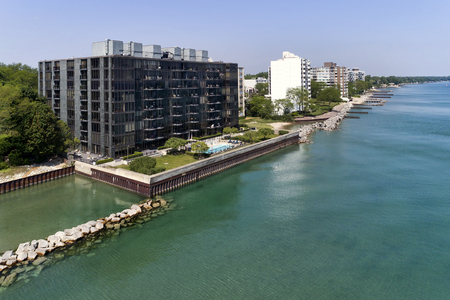 Aerial view of the 1420 Sheridan Road condominium building and others along the shoreline in Wilmette, Illinois taken with a quadcopter drone. USA