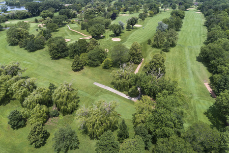 Aerial view of a suburban Chicago golf course with fairways and sand traps in Glencoe, IL. USA