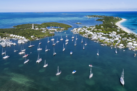 Aerial view of the harbour and lighthouse in Hope Town on Elbow Cay off the island of Abaco, Bahamas.