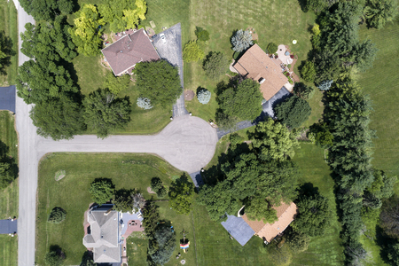 Aerial view of a luxury neighborhood with mature trees and large lots in a Chicago suburban neighborhood in summer. Deer Park, IL. USA