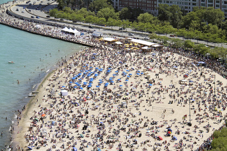 Crowded Oak Street beach in summer beside Lake Shore Drive in Chicago, IL. USA