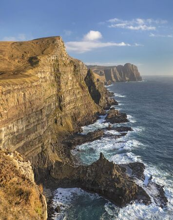 View along the southern coastline of the cliffs and crashing waves on the island of Suduroy in the Faroe Islands. Reklamní fotografie