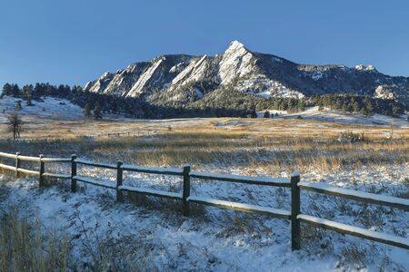 Chautauqua Park in winter with the snow-covered on Green Mountain just after sunrise in Boulder, Colorado.