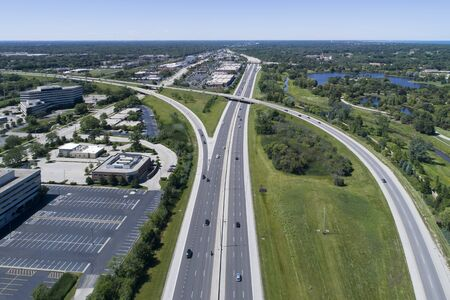Aerial view of a highways, overpasses, ramps and office buildings in a suburban Chicago suburban setting.