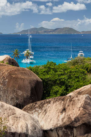 View above the Baths with boats moored in the distance on Virgin Gorda in the British Virgin Islands. Stock Photo