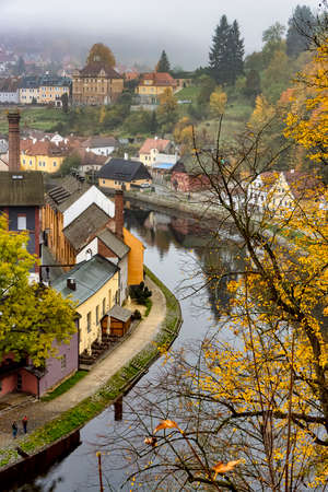 View of the old buildings along the river in the picturesque, fairy tale town of Cesky Krumlov, South Bohemia region of the Czech Republic.