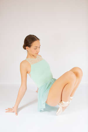 Young beautiful girl warming up for ballet