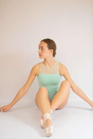 Young beautiful ballet dancer posing for camera