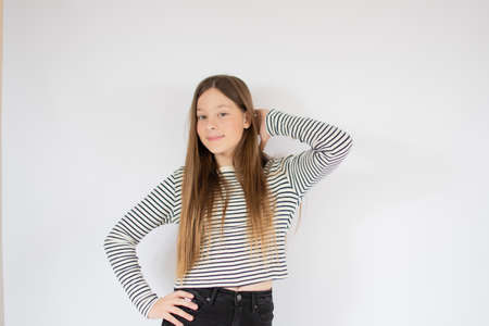 Young girl with striped shirt smiling