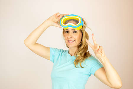 Woman with diving glasses on summer vacation