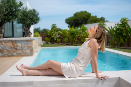 Beautiful woman lying by the pool