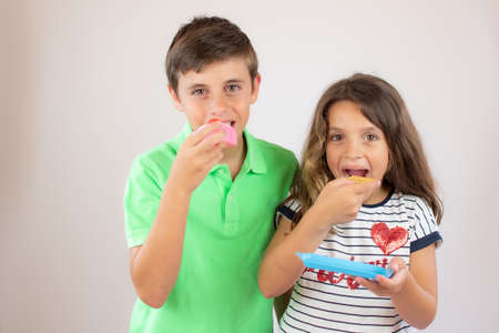 Two friends eating a piece of cake Stock Photo