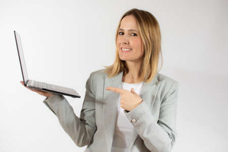 Business young woman holding laptop computer over white background Banco de Imagens