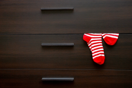 chest of drawers: Chest and striped socks  Stock Photo