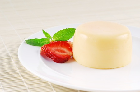 flan: Pudding with strawberries, a beautiful dessert  Stock Photo