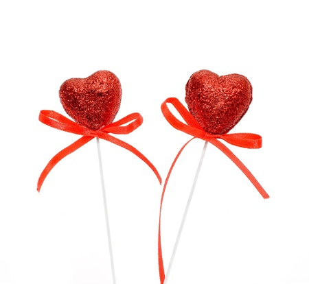 Two heart with a red bow, a symbol of Valentine photo