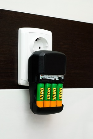 Charger with batteries to charge  photo