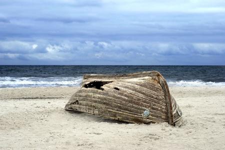 overturned: Overturned boat on beach