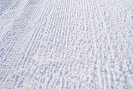 Winter picture. The texture of the trampled snow on the ski track. Bright abstract background ideal for any design