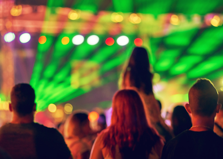 Blurred Youth Music Festival of pop music. Laser show on the stage. The crowd of fans. Bright abstract background ideal for any design. Blurred bokeh basic background for design 스톡 콘텐츠